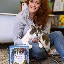 Octavia, Away With Words' bookstore cat, with Nordic Folktales book