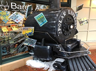 A holiday window display at Bards Alley in Vienna, Virginia, that features the Polar Express.