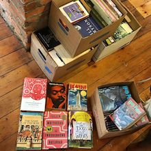 A box of new arrivals at Barner Books