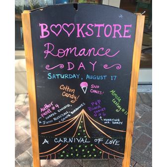 Sandwich board outside a bookstore promoting Bookstore Romance Day