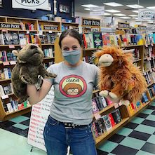 A bookseller with new puppets at Browseabout Books