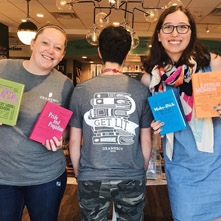 "Booksellers showing off ""Get Lit"" T-shirts and classic books"
