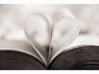 Book pages bent in the shape of a heart