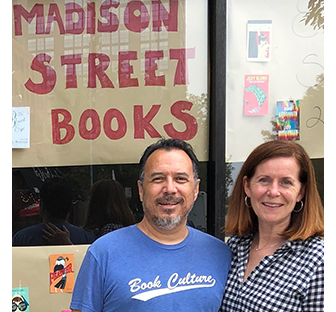 Two people standing in front of Madison Street Books