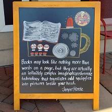 A sandwich board in front of Mitzi's Books