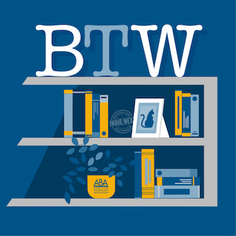 BTW logo on shelving with books and a cat