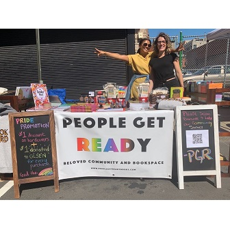 People Get Ready selling books at a New Haven Pride event.