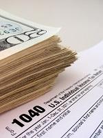 Tax form and $20 bills