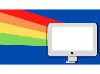Computer with rainbows emitting from its screen