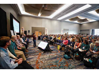 Hundreds of booksellers seated in front of the ABA Board at the Winter Institute Town Hall