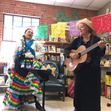 A Children's Book Week event featuring singers and guitar players at Old Firehouse Books