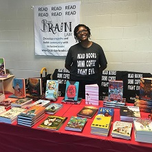 Brain Lair owner Kathy Burnette with an array of books
