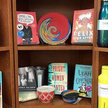 A shelf of books celebrating Pride at Undercover Books