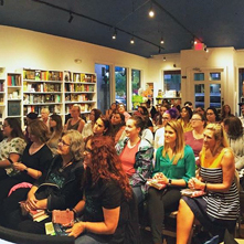 A crowd gathers for an author event at Writer's Block Bookstore
