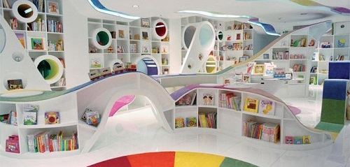 The children's section of a bookstore is a great place to use neutral colors alongside colorful books