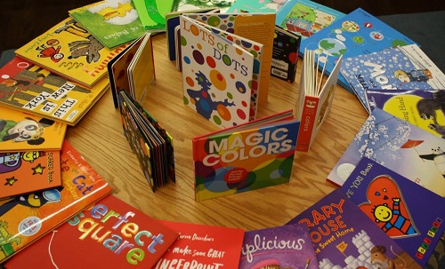 A rainbow display of children's books at [words] Bookstore