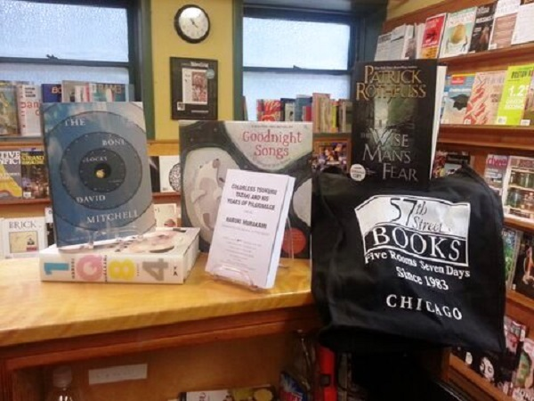 57th Street Books shows off its items for raffle, including a signed 1Q84 by Haruki Murakami.