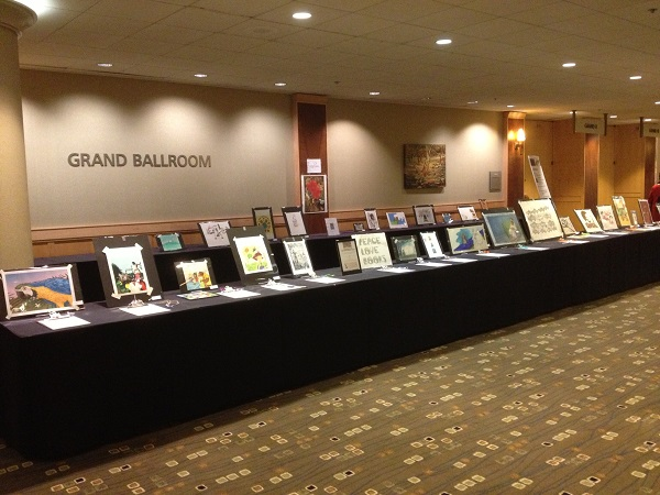Artwork from children's book illustrators on display at the ABFFE Silent Auction for Free Speech in Children's Books.