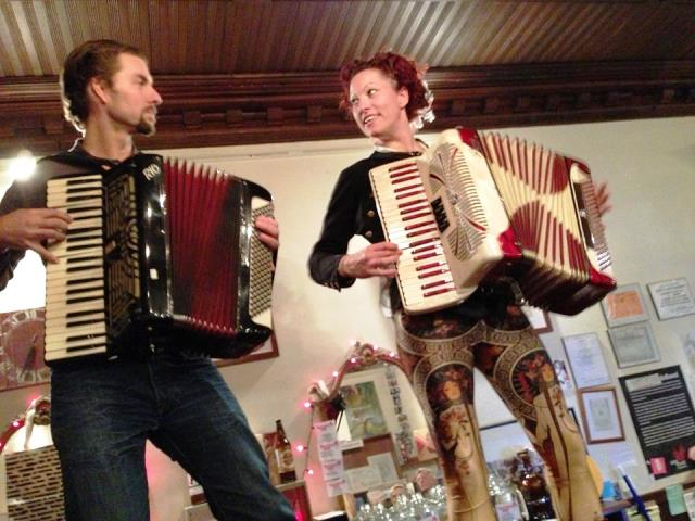 Amanda Palmer and Lance Horne perform atop Spotty Dog Books & Ale's bar