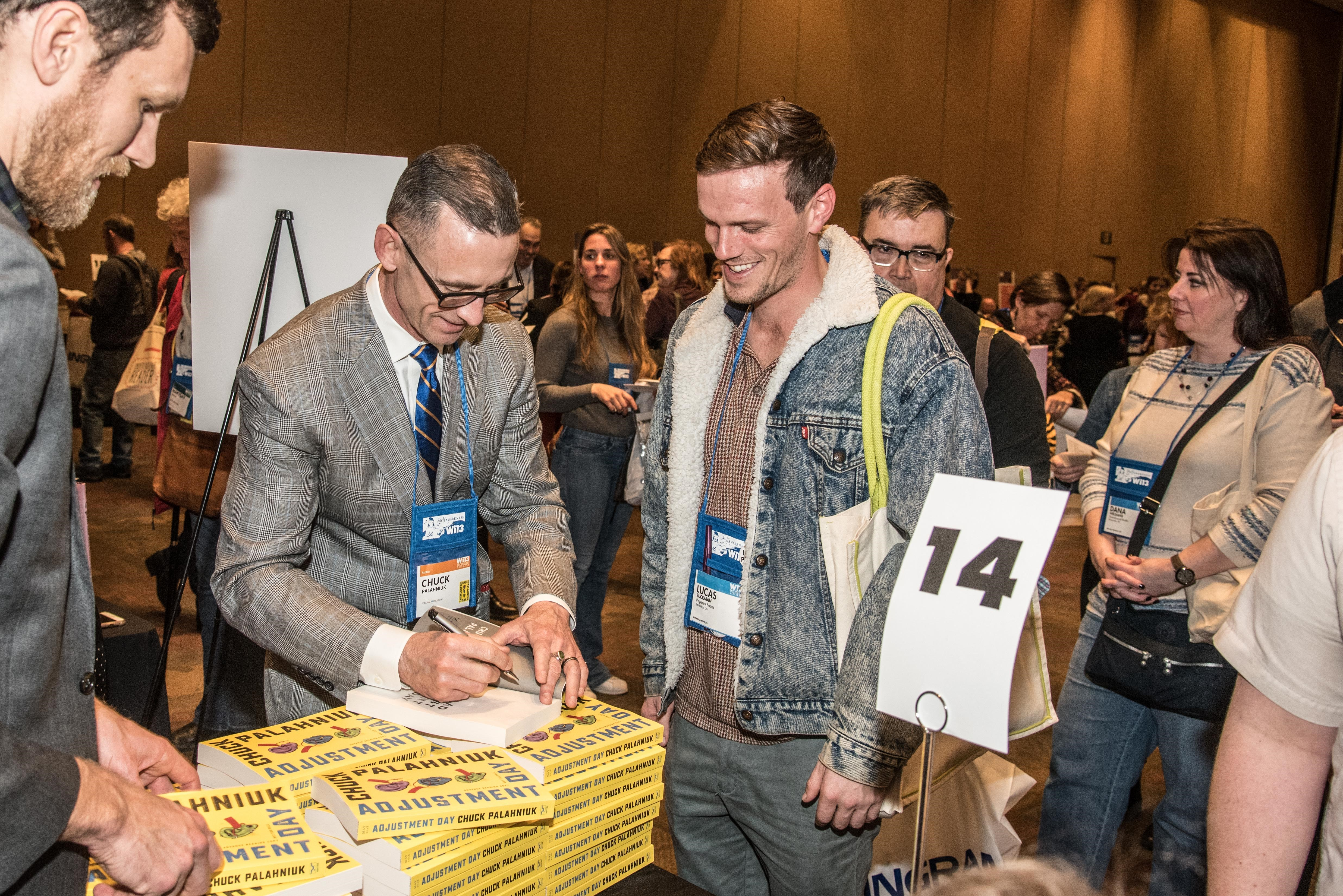 Chuck Palahniuk signs his newest novel at the Author Reception.