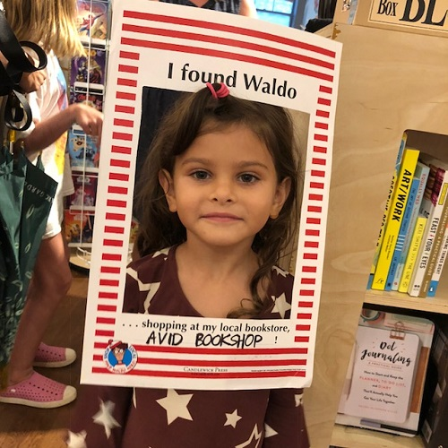 """Participant poses with """"I found Waldo"""" frame at Avid Bookshop in Athens, Georgia."""