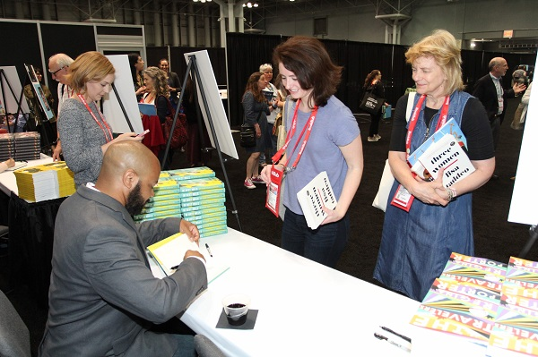 De'Shawn Charles Winslow signed copies of his upcoming book during the Happy Hour Author Signing event.