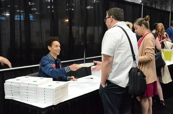 Author Malcom Gladwell signed copies of his book after the Adult Book & Author Breakfast.