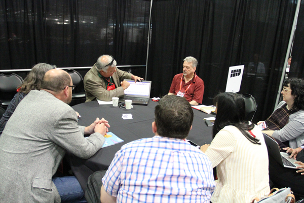 Booksellers discuss point-of-sale systems during roundtables in the ABA Member Lounge.