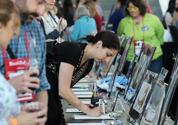 Auction attendees placed silent bids on a variety of artwork from children's illustrators.