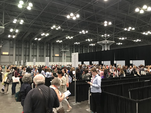 BookExpo attendees lined up to have books autographed.