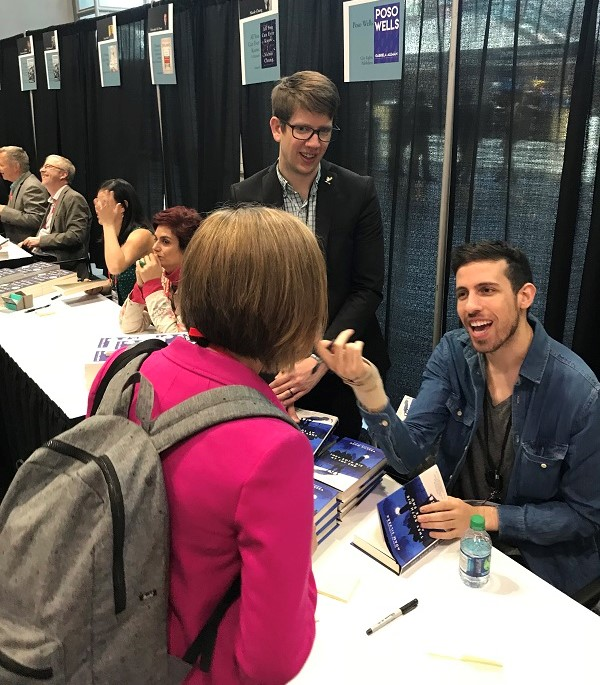 Adam Silvera signs in the ABA Member Lounge following the lunch.