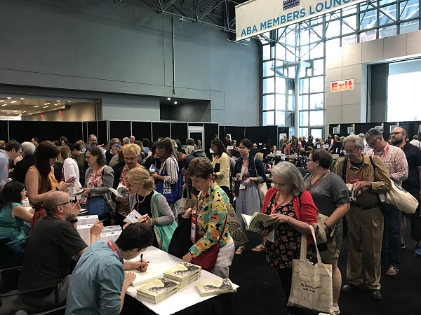 Booksellers visit the ABA Member Lounge for exclusive author signings.