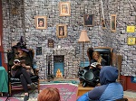 Two participants read Harry Potter and the Sorcerer's Stone at Bookshop West Portal.