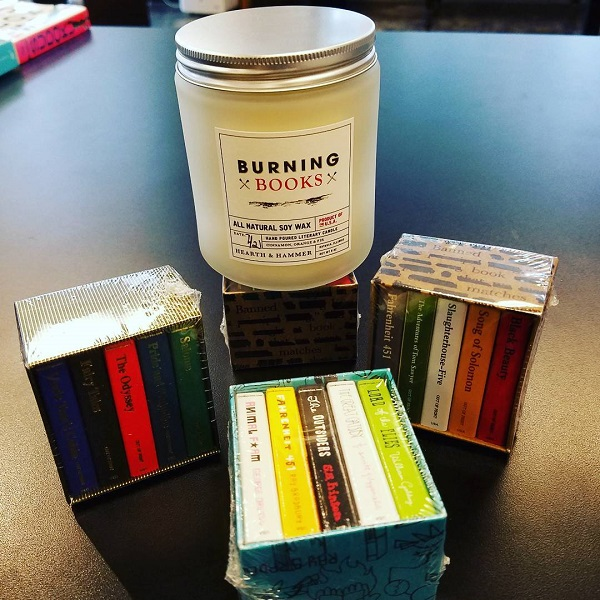Books & Books sets out a burning books-scented candle as part of its Banned Books Week display.