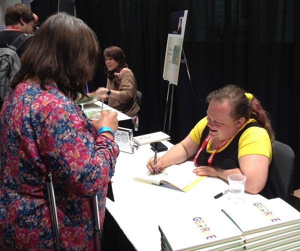 Author Alex Gino signs copies of George for booksellers at the ABA Member Lounge following the lunch.