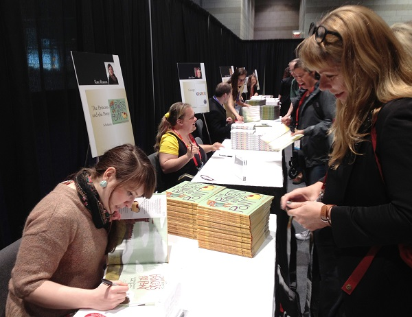 The Princess and the Pony author and illustrator Kate Beaton signs copies of the picture book for booksellers.