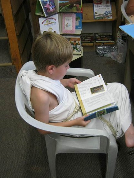 A young reader enjoys Chapter One's Percy Jackson book camp.