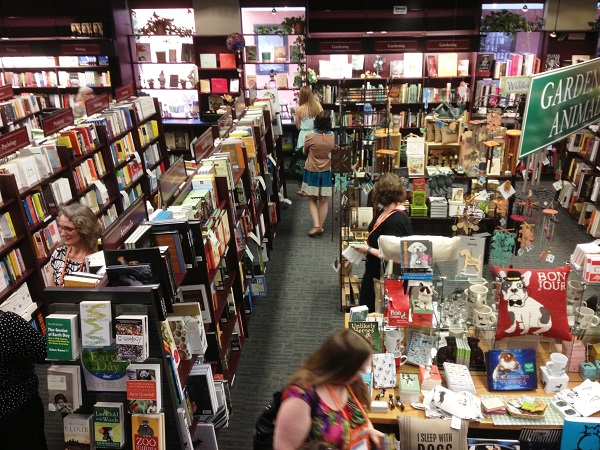 Booksellers browse the first-floor offerings at Vroman's.