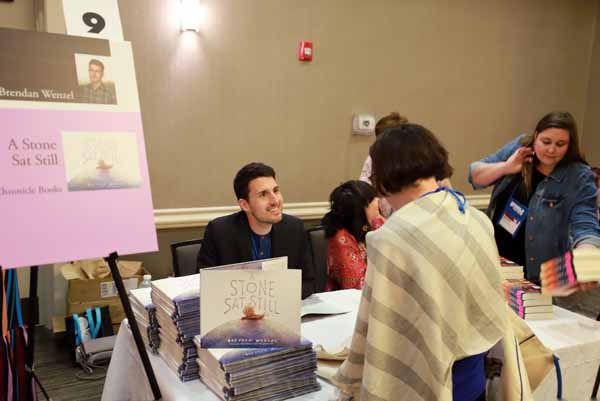 "Brendan Wenzel signed copies of ""A Stone Sat Still"" at the Author Reception."