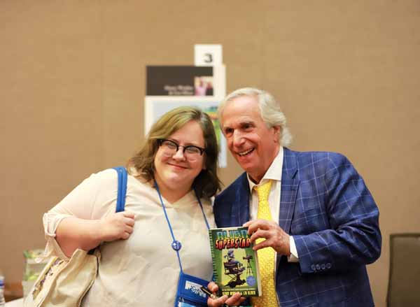 Henry Winkler, co-author of the Alien Superstar series with Lin Oliver, took pictures with booksellers at the Author Reception.