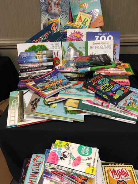 Booksellers donated more than 100 books for the OASIS Intergenerational Tutoring Program.