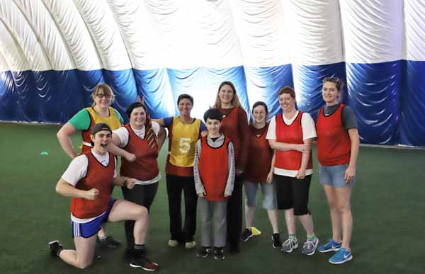 The red team poses at the first-ever quidditch match at Children's Institute.