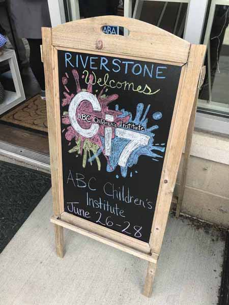 Riverstone Books decked out its sandwich board for arriving booksellers.