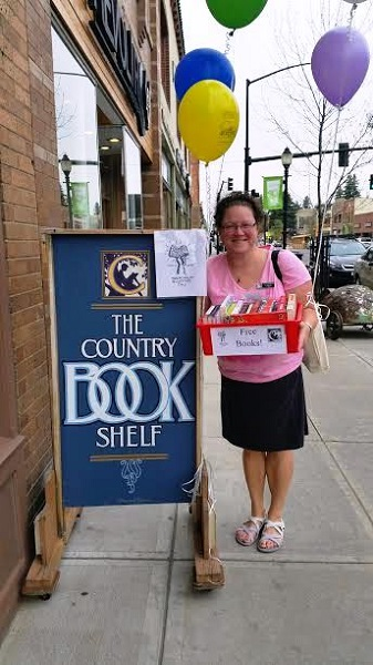 Cindy Hinson of Country Bookshelf stood in front of the store and passed out free books to passersby.