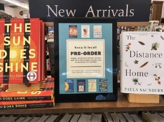 "Devaney, Doak and Garrett created a ""Keep it local!"" sign that reminds customers to pre-order the books listed and get a signed copy."