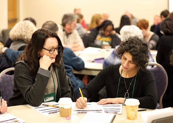 Booksellers participate in an educational session on visual merchandising.