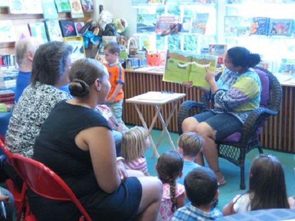 Soon-to-be kindergartners gather for story time at Eight Cousins.