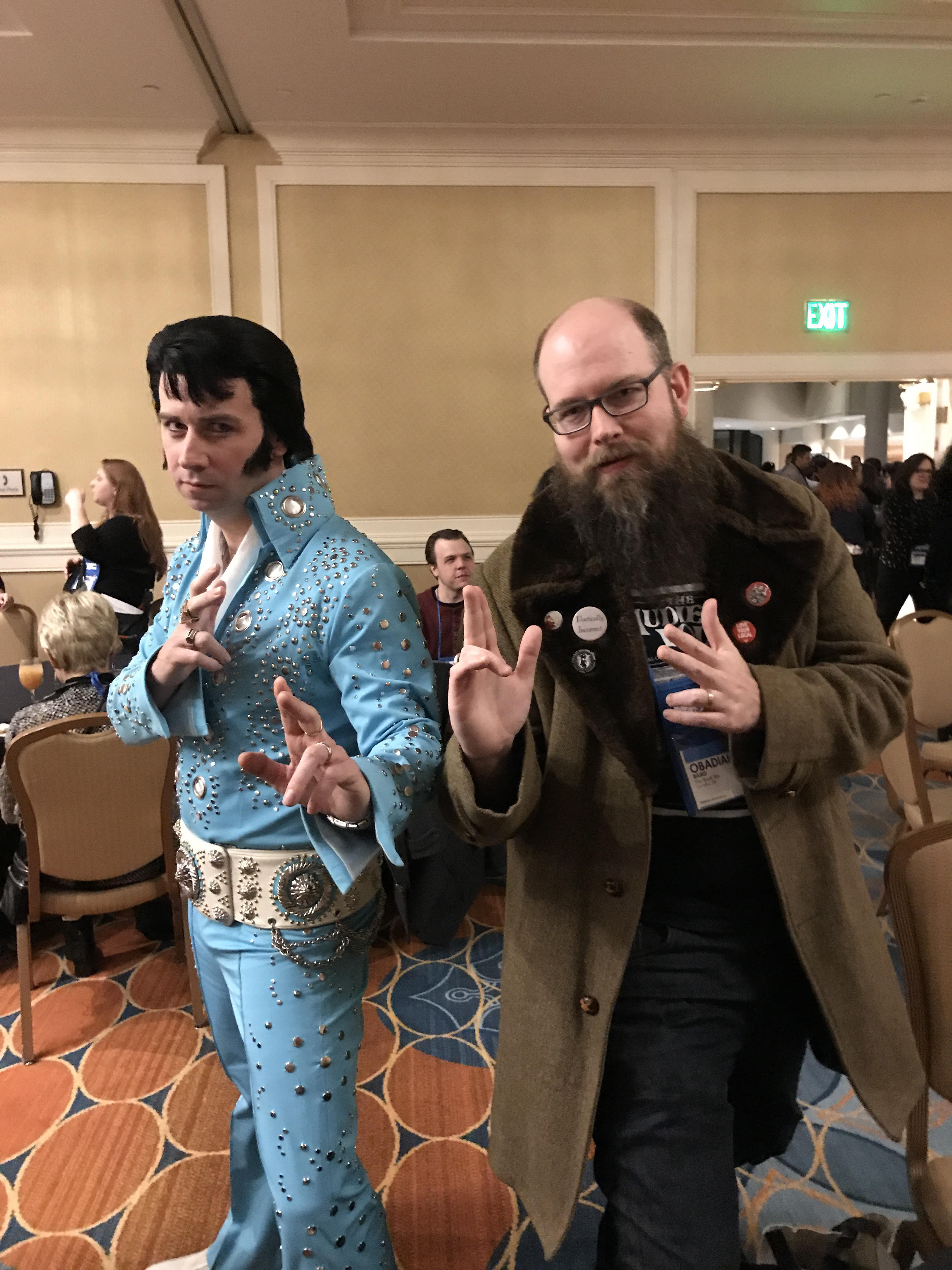 """Obadiah Baird of The Book Bin strikes a pose with """"Elvis"""" at the Ingram reception."""