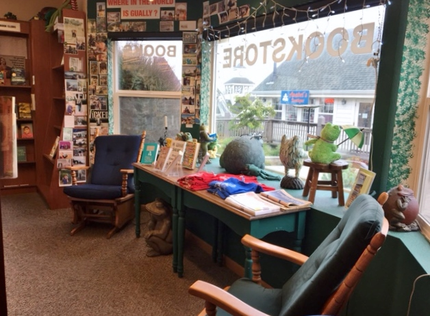 Interior of Four Eyed Frog Books, with chairs and a table by the picture window
