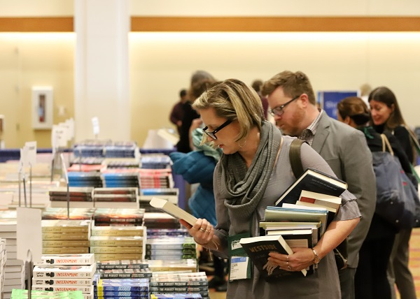 Booksellers peruse upcoming titles in the Galley Room.